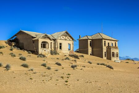 kolmanskop: Kolmanskop, ghost town in the area of the diamond mines, Namibia, esterior of a house. Stock Photo
