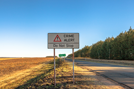kidnap: Road sign of an insecure area, without any kind of protection and high crime. Lothair on the border with Swaziland and Mozambique, South Africa. Stock Photo