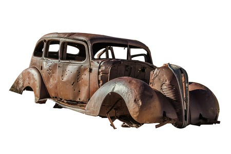 wheelspin: Old Beetle wreck butchered with machine guns. Isolated on white background. Stock Photo