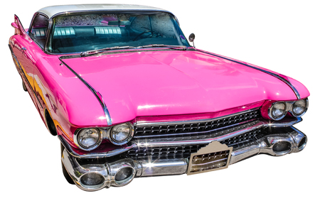 Luxurious vintage pink Cadillac Eldorado on a white studio background.