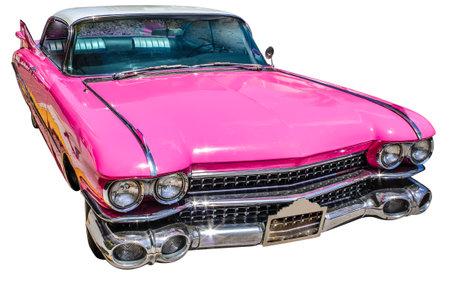 Luxurious vintage pink Cadillac Eldorado on a white studio background.