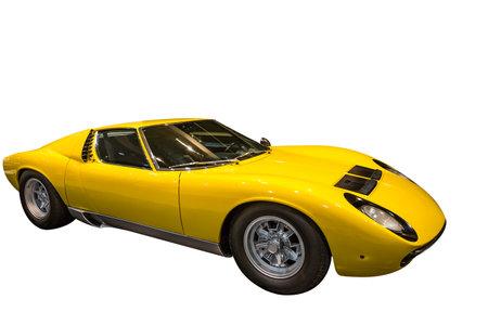 lamborghini: Side view of a luxurious yellow Lamborghini sports car on a white background. Editorial