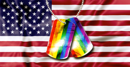 American flag background and army dogtags with rainbow flag of pride. Concept of  opening to the free expression of any sexual orientation. Stock Photo - 41947744