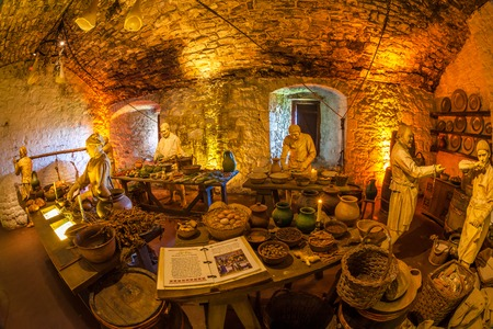 Representation of an ancient farm scene in historic Stirling Castle, Scotland, Europe. Typical food goods: cereals, meat and vegetables, cooked by medieval peasants.