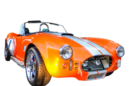 ford: The AC Cobra, sold as the Ford Shelby AC Cobra 427 in the United States on white background.