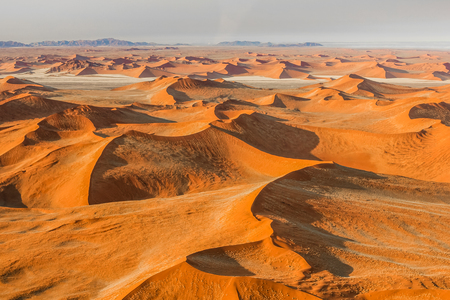 recedes: Aerial view of the Sossusvlei desert in the Namib Naukluft National Park, Namibia. Stock Photo