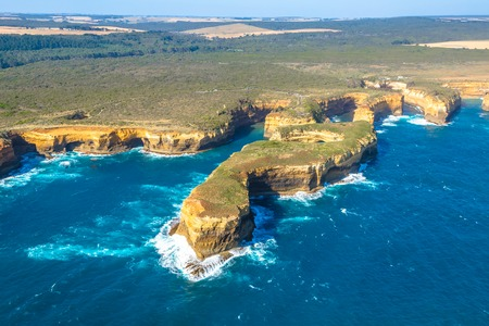 ard: Aerial view of Mutton Bird Island in Loch Ard Gorge on the Great Ocean Road in Victoria, Australia famous attraction of the Port Campbell National Park. Stock Photo