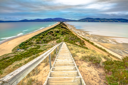 isthmus: Isthmus, the Neck, connecting North and South Bruny Islands in Tasmania, Australia. Neck Game Reserve at sunset area that protects penguins Australians in Bruny Island, Tasmania, Australia. Stock Photo