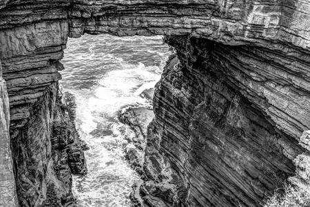 tasman: Tasman Arch is an unusual geological formation found in the Tasman National Park, Tasman Peninsula in the south east coast of Tasmania in Australia