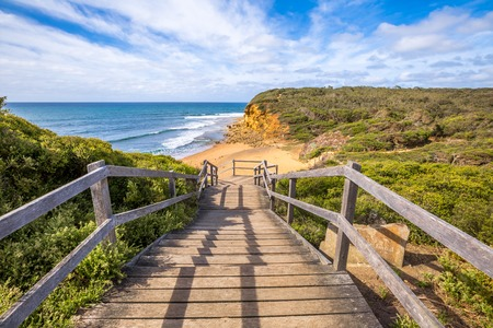panoramic beach: Walkway of the legendary Bells Beach - the beach of the cult film Point Break, near Torquay, gateway to the Surf Coast of Victoria, Australia, where he began the famous  Great Ocean Road Stock Photo