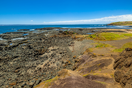 miller: Kitty Miller Bay at low tide in Phillip Island, Victoria, Australia.
