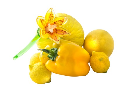 yellows: Group of assorted bright yellow fruit and vegetable with glass flower. Isolated on white background.