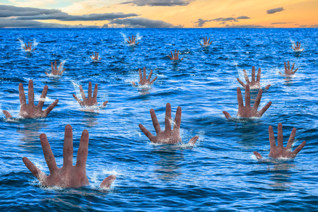 Hands of a men sinking and drowning in the sea. Business concept failed, bugdet not reached, bankruptcy risk company, concept drowning, bankruptcy, financial emergency.