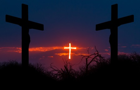 Shining cross of Christ saving sinnes from the darkness. Concept of salvation, resurrection and forgiveness. The two sinners are leaning forward to the saving light, aspiring for salvation.