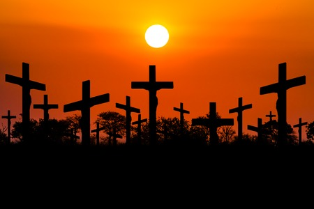 sinners: Backlight Crosses of a crucifixion at sunset. Stock Photo