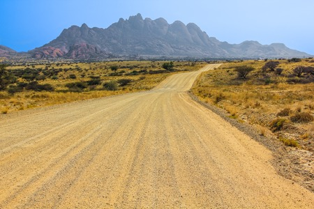 spitzkoppe: Dirt road to Spitzkoppe in the dry season, a mountain of granite rock formation located between Usakos and Swakopmund in the Namib Desert, Namibia.