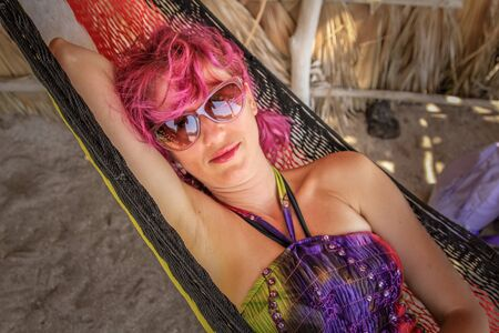 relaxes: Portrait of young woman while relaxes on a hammock. A Conception Baja, California Sur, Mexico. . Stock Photo