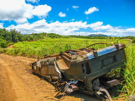 upturned: Scenic view of an old car on a countryside road to Jaws surf break beach on the island of Maui, Hawaii, U.S.A. Stock Photo