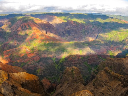 waimea canyon state park: Aerial view of the spectacular and colorful landscape of Waimea Canyon State Park, also called the Grand Canyon of the Pacific, at sunset in Kauai, Hawaii, United States.