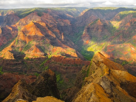waimea canyon state park: Aerial view of the spectacular and colorful landscape of Waimea Canyon State Park, also called the Grand Canyon of the Pacific, at sunset in Kauai, Hawaii, United States. .