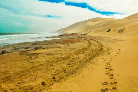 desert footprint: Sandwich Harbour, Walvis Bay, is a part of the Namib Naukluft Park Namibia. Wild and remote area accessible only by off-road.