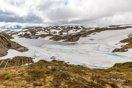 fv: Norway glacier lake. Lysevegen scenic road in spring FV 500: Sirdal to Kjerag, Norway, Europe.
