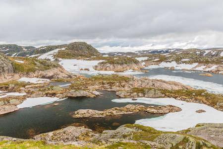 fv: Norway mountain landscape. Lysevegen scenic road in spring FV 500: Sirdal to Kjerag, Norway, Europe.
