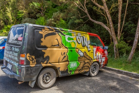 airbrushing: Sydney, Australia - January 9, 2015: Hippie van with Bob Marley One Love airbrushing hand made. Typical campers from Australian company: Wickedcampers. Editorial