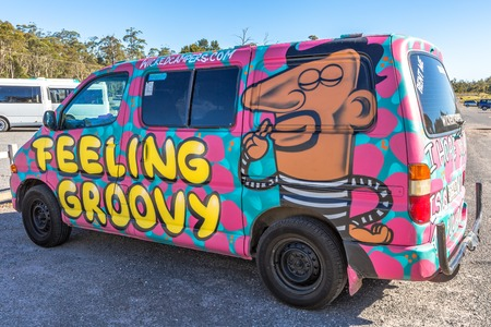 airbrushing: Sydney, Australia - January 9, 2015: Hippie van with Feeling Groovy airbrushing hand made. Typical campers from Australian company: Wickedcampers. Editorial