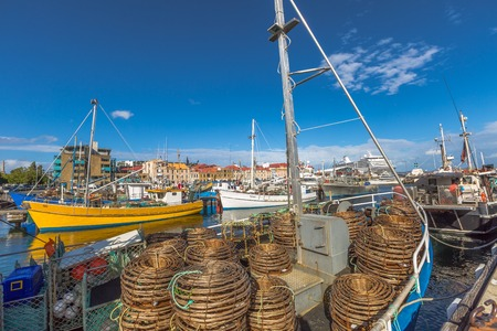 lobster boat: Hobart, Tasmania, Australia - January 16, 2015: Fishing Boats with lobster traps on boat in Franklin Wharf