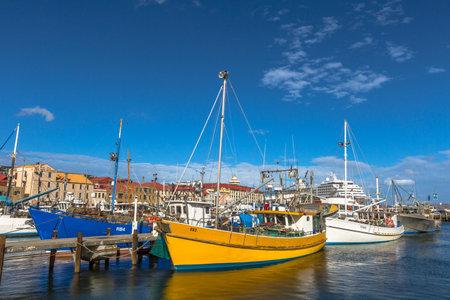 tasmania: Hobart, Tasmania, Australia - January 16, 2015: Fishing Boats docked at the wooden jetty in Hobart Harbour, Franklin Wharf