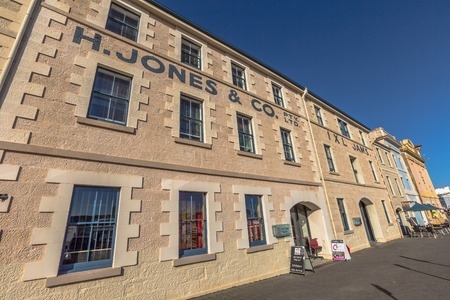 henry: Hobart, Tasmania, Australia - January 16, 2015: Henry Jones Art Hotel, Hunter Street, oldest waterfront warehouses. The hotel served as a jam factory from the 1890s to the 1970s.
