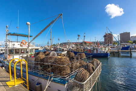 traps: Hobart, Tasmania, Australia - January 16, 2015: Fishing Boats with lobster traps on boat in Franklin Wharf