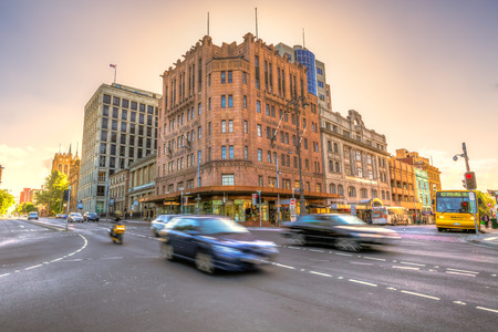 Hobart, Tasmania, Australia - January 16, 2015: Traffic in the center of Hobart town at sunset. Photo taken with motion effect for cars