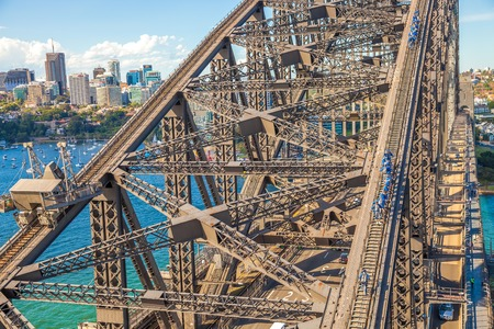 steel arch bridge: Sydney, Australia - December 29, 2014: Harbour Bridge, one of most  photographed landmarks. Its the worlds largest steel arch bridge with the top of the bridge standing 134 meters above harbor