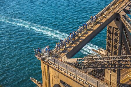 is well known: Sydney, Australia - December 29, 2014:Tourists climbing the Bridge. The Sydney Harbour Bridge is one of Australias most well known and photographed landmarks. Editorial