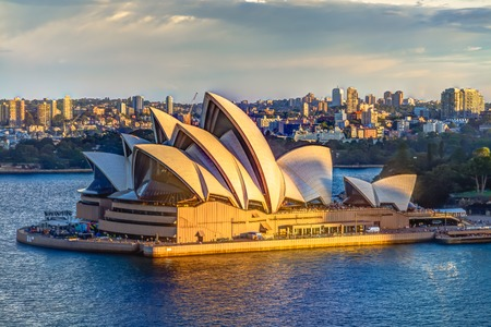 tower house: Sydney, New South Wales, Australia - December 29, 2014: Profile of Sydney Opera House at sunset seen from Sydney Harbour Bridge Editorial