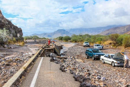 baja california: Nopolo, Baja, Baja California Sur, Mexico - August 25, 2013: Collapsed highway linking La Paz to Loreto during the tropical storm named Juliette