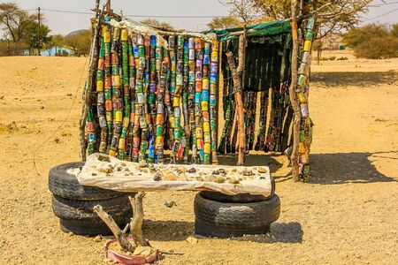 spitzkoppe: Spitzkoppe  area, Namibia- August 28, 2012: A hut in front of a stall with craft items for sale, located in a poor area near the Spitzkoppe. this shelter is hand made with cans of fanta and coke Editorial