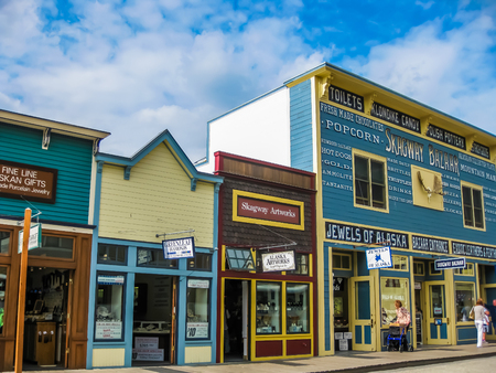 to seem: Skagway, Alaska, United States - August 7, 2009: Klondike Gold Rush National Historic Park. Historic buildings are interspersed with new modern buildings. Its streets seem to come from in another age.