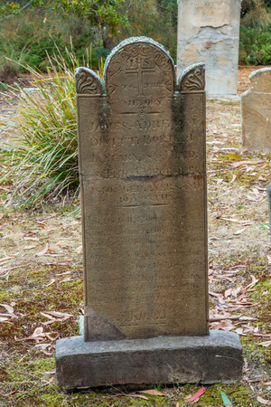 penal: Port Arthur,Tasmania, Australia - January 15, 2015: Old tombstone in the Isle of the Dead hystoric site, used as the graveyard for the penal settlement of Port Arthur from 1833 to 1877