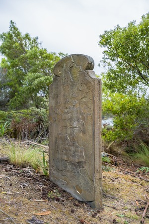 arthur: Port Arthur,Tasmania, Australia - January 15, 2015: Old tombstone in the Isle of the Dead hystoric site, used as the graveyard for the penal settlement of Port Arthur from 1833 to 1877