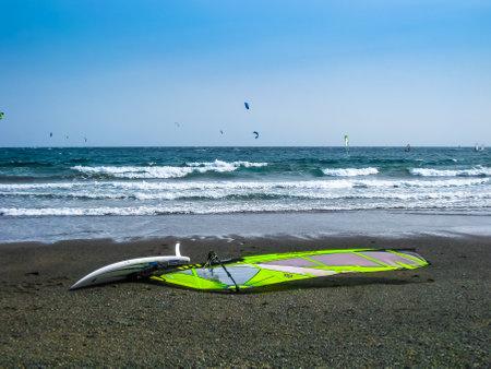sail board: Tenerife, Canary Islands, Spain - December 22, 2008: Windsurfing board and sail at El Medano beach Editorial