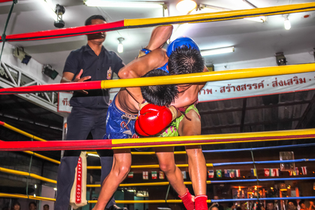 boxing match: Chiang Mai, Thailand - July 25, 2011: Muay Thai Thai boxing match in the Thapae Boxing Stadium in town. Editorial
