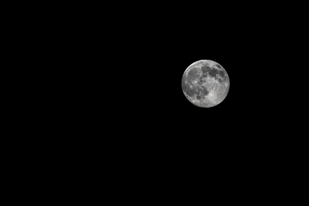 apparent: Lunar perigee, Bologna, Italy 12 july 2014. A super full moon is the coincidence of a full moon with the closest approach to the Earth. the largest apparent size of the lunar disk as seen from Earth.