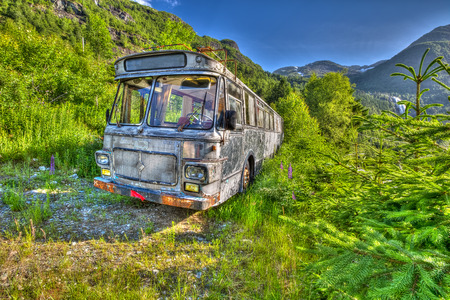 unused: Unused vintage bus abandoned in the countryside with blue sky and sunshine, Ulvik, Norway, Europe