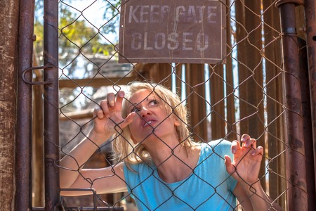 psychotic: Psychotic woman in the cage, keep gate closed.