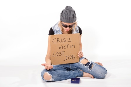 begging: Homeless, victim of the crisis begging for money with carton. Composition on white background, isolated. Stock Photo