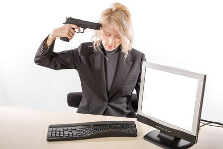 shots: Business woman suiciding with a gun in her office at her desk. with blank computer screen. white background.