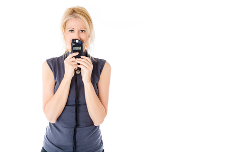 metering: Model woman holding a flash meter for exposure metering, isolated on white background, copy space. Stock Photo